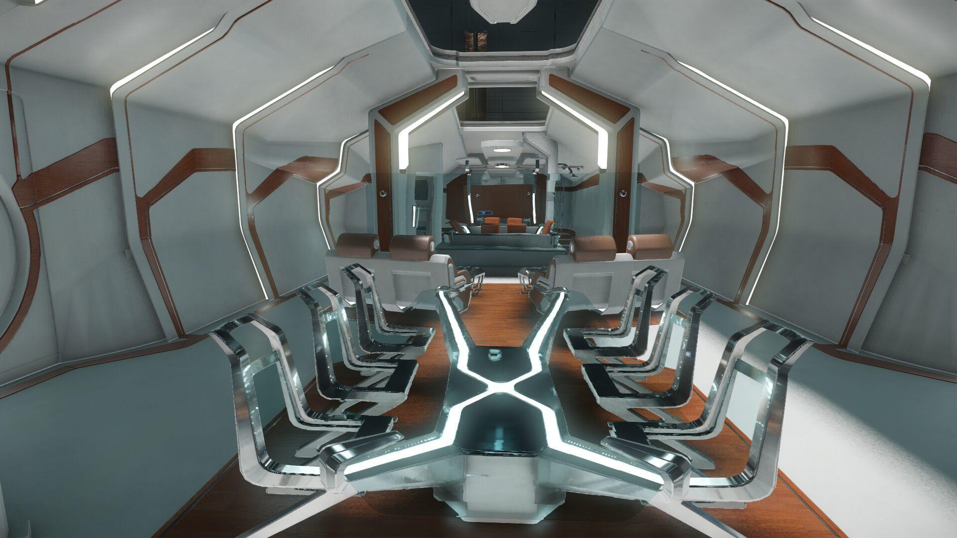 Wygląd wnętrza - główny pokład - sekcja dla gości - stół konferencyjny - widok w kierunku tyłu statku
